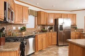 kitchens with stainless appliances tl806a timberland ranch kitchen with oak cabinets and stainless