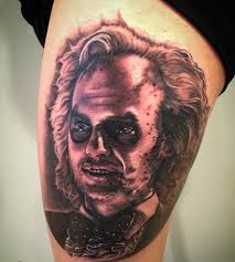 black and grey photorealism beetlejuice portrait tattoo by artis
