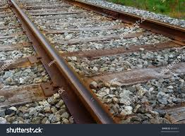 rusty train close rusty train track gravel stock photo 6043612 shutterstock