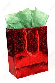 gift bags christmas shiny christmas gift bag with green tissue on white stock