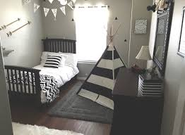 our little loves carson s big boy room gray black white gold boy room wall decals black white decals triangle wall