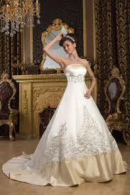 a line strapless embroidered ivory and champagne wedding dresses