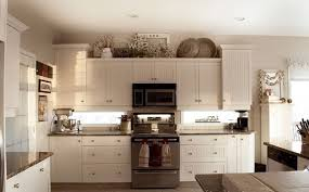 decorating ideas for kitchen cabinet tops above kitchen cabinet decor classic white wooden wall cabinet