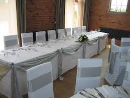 silver chair covers a tale of two weddings carraige chair covers silver swag