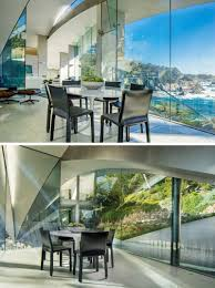 interior glass walls for homes this sculptural house combines stainless steel concrete and