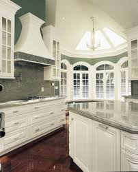 kitchen island with cooktop and seating granite countertop best way to clean white cabinets cooktop