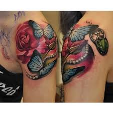 realistic flower butterfly diamond tattoo by rock tattoo