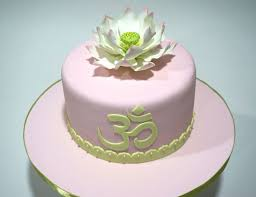 Lotus Flower With Om Symbol - a sugar lotus flower and an om symbol convey wishes for a happy