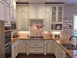 kitchen cabinets highlighted in van brown glaze effects