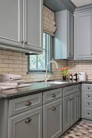 gray kitchen cabinets with black granite gray laundry room cabinets with honed black granite