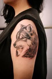 wise shaggy wolf arm wolf tattoos
