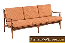 restored mid century modern sofa in burnt orange