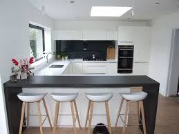Designer White Kitchens by This Striking White Kitchen Consists Of Matt White Cabinetry And