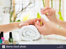woman in nail salon gets manicures stock photo royalty free image