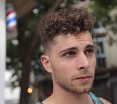 shaved sides with a long curly top on haircuts for men pictures
