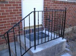 decor brick wall design ideas with wrought iron railing also