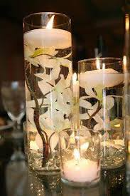 Floating Candle Centerpieces by Purple Floating Candle Centerpiece Wedding Pinterest