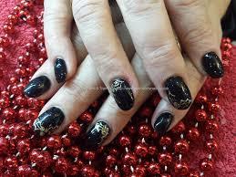 black christmas nail design black snowflake christmas nails nail