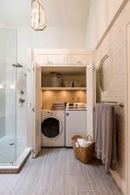 laundry closet laundry room beach style with ceiling light