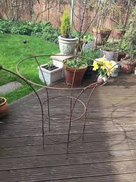 2 vintage garden wrought iron peony cages plant supports in
