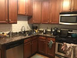 what backsplash goes with brown cabinets white subway tile baltic brown aka tropical brown
