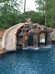 inground swimming pool slide grotto pools by mitchell custom