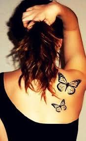 black butterfly on shoulder tattoomagz