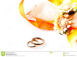 wedding flowers background gold wedding rings near ribbon and flowers with space for text