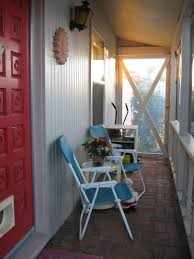 houses small front porch with screen and white beadboard