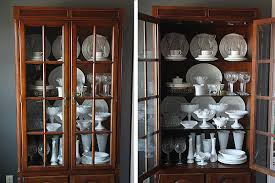 thrifty thursday styling my glass front cabinets suzanne