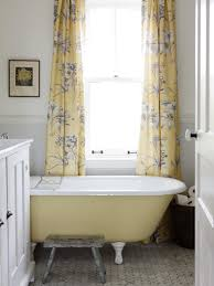 preety yellow accent in long draw curtain glass window near tiny