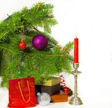 branch of a decorated trees candle and gif