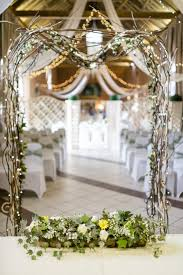 ivory arch with rustic twigs and twinkling fairy lights www