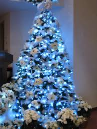 snowed in u201d 9 ft tree with white poinsettias u0026 led lights by
