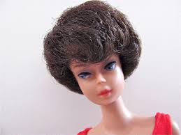 how to cut a bubble cut hair style brunette bubble cut barbie doll in original swimsuit and heels