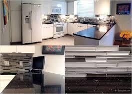 Whitekitchencabinetsblackgalaxycountertopgrayglassmosaic - Kitchen backsplash white cabinets