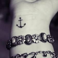 cute collar bone tattoos small black anchor tattoo on right below collarbone