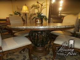 drexel heritage dining table drexel heritage dining table with thick marble top resting on a