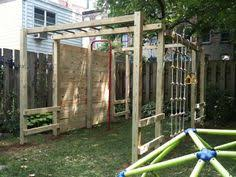 outside jungle gym made from fence posts and metal bars from an