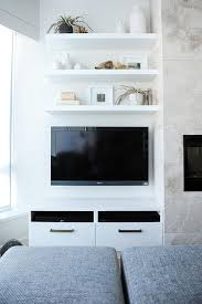 Floating Shelves For Tv by Three Floating Shelves Over Wall Mount Tv Transitional Living Room