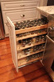 Pull Outs For Kitchen Cabinets by Five Cream Wooden Pull Out Shelves On The White Wooden Cabinet