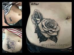 bird tattoos on hips rose tattoo cover up black and grey on stomach hip by kylie wild