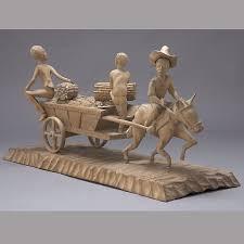 simeon haitian wood carving the harvest wagon