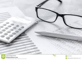 Office Desk Close Up Business Accounter Work With Taxes And Calculator On Office Desk