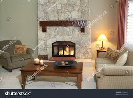 cozy living room fireplace turned on stock photo 10006261