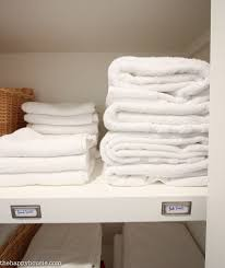 how to completely organize your linen closet the happy housie