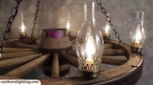 wagon wheel light fixture large wagon wheel chandelier cast horn designs youtube