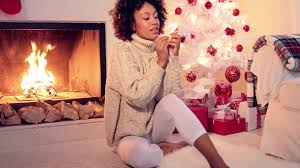lovely black woman in white leggings and sweater seating next to