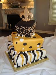 wedding cake new orleans gold black stripes dots and swirls new orleans saints cake