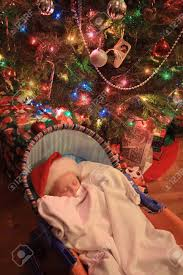 a young baby enjoying a peaceful sleep under a christmas tree